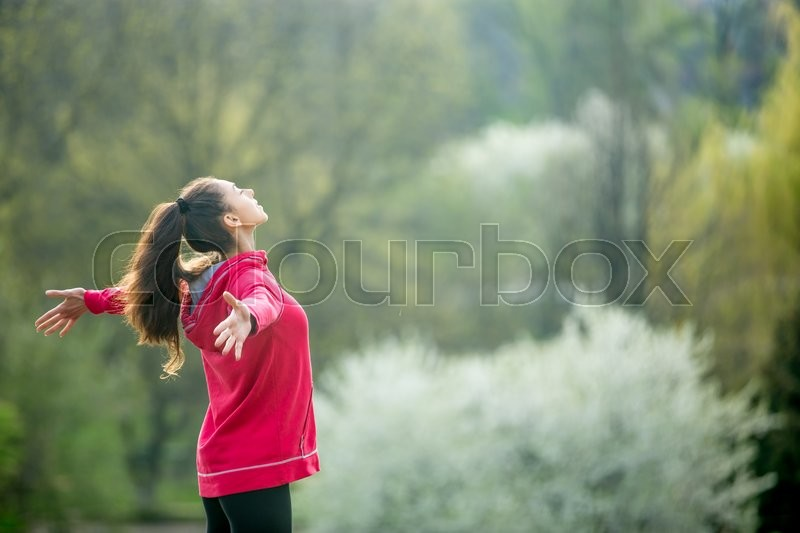 Stock image of 'Profile portrait of happy sporty woman relaxing in park. Joyful female model breathing fresh air outdoors. Healthy active lifestyle concept. Copy space'