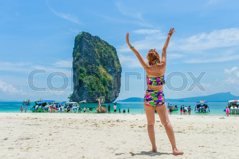 Stock image of 'Beautiful woman relexing on the beach. Poda island. Thailand'