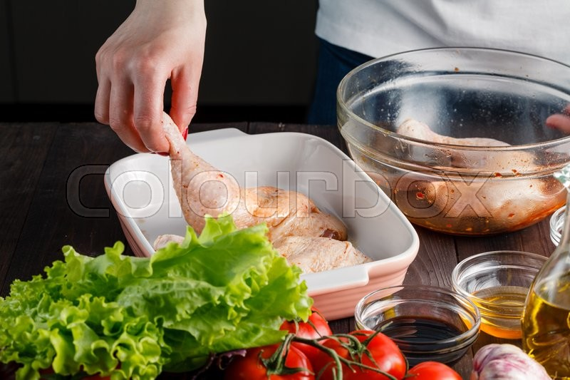 Stock image of 'Uncooked chicken thigh - chicken with vegetables'