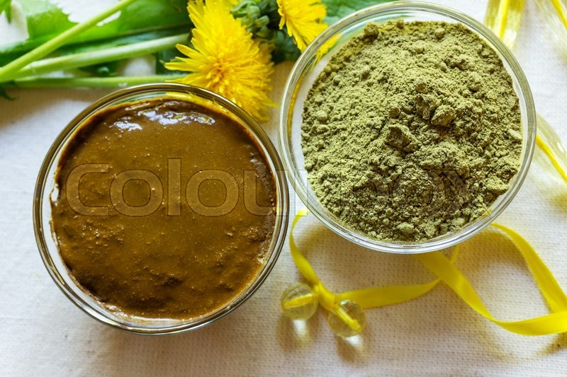 Stock image of 'Henna powder. Henna paste. Prepare the henna paste at home. Still life with henna and dandelions. Focus on the powder.'