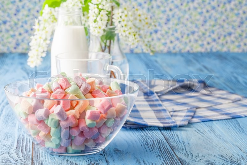 Stock image of 'Colorful Marshmallow and a glass of milk'