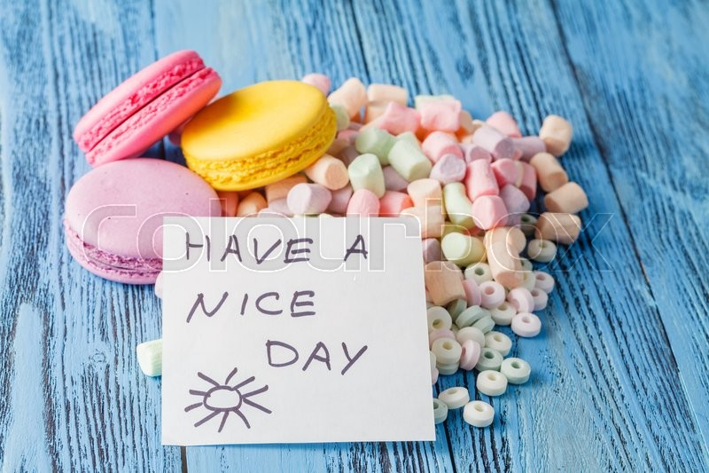 Stock image of 'Party decoration. Sweets, marshmallow and note have a nice day'