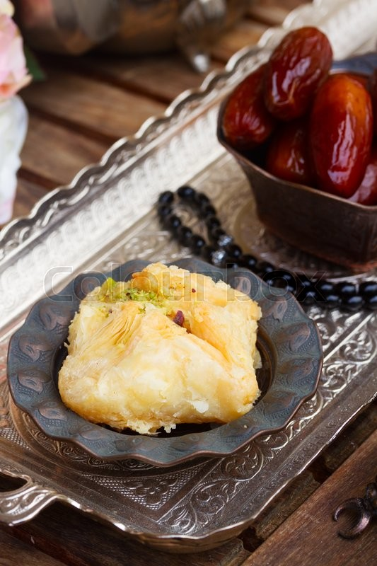 Stock image of 'Turkish delights baklava in copper vase close up on  oriental tray'