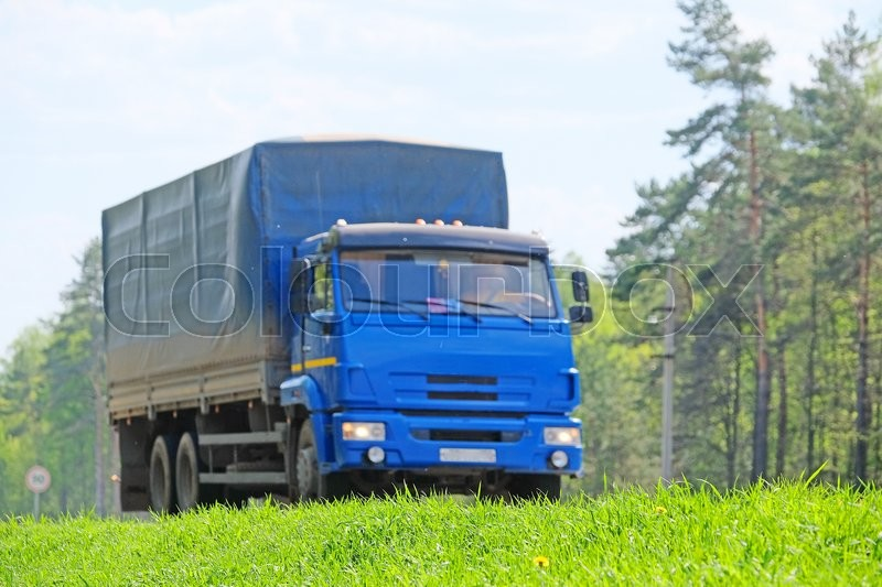 Stock image of 'Moscow region, Russia - March, 10, 2016: Truck on a highway in Moscow region, Russia'