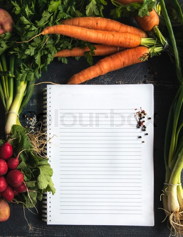 Stock image of 'Blank recipe book surround with vegetables'