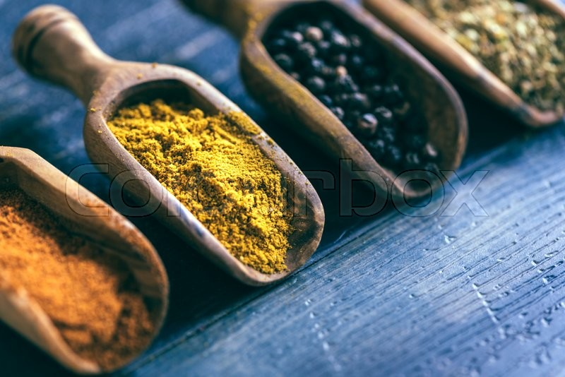 Stock image of 'Curry spice in the wooden spoon,selective focus '