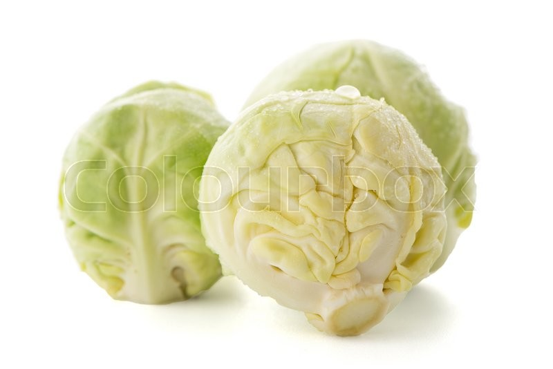Stock image of 'Fresh brussels sprouts isolated on white background.'