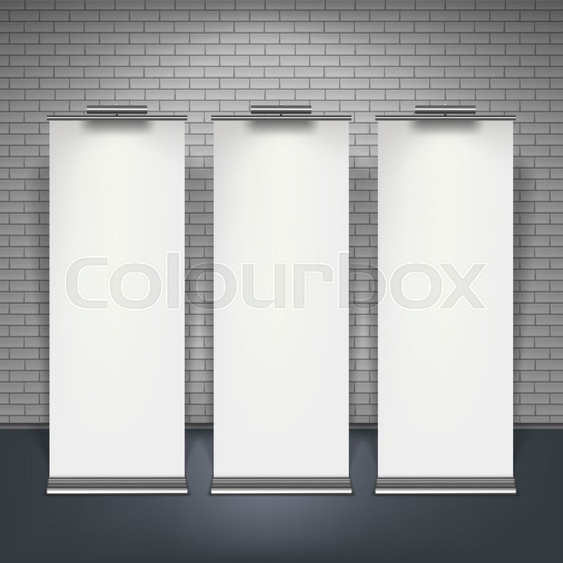 Stock image of 'Blank roll up banners set isolated over brick wall, illustration.'