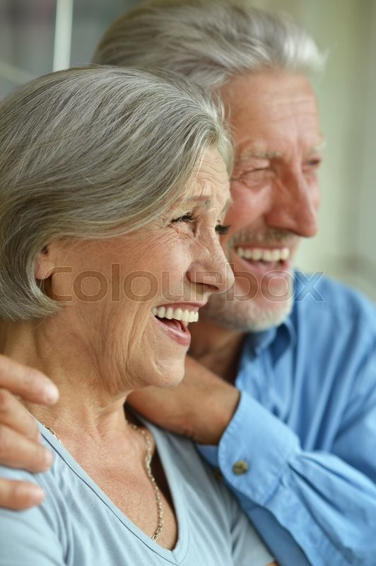 Stock image of 'Portrait of a happy senior couple at home'