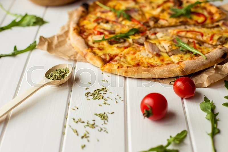 Stock image of 'delicious portioned pizza and text space on white wooden background top view'