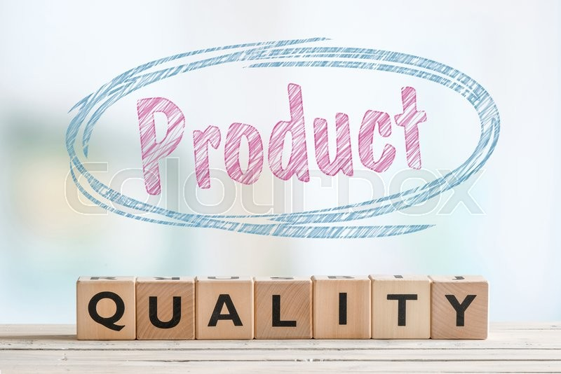 Stock image of 'Product quality badge on a wooden table in bright environment'