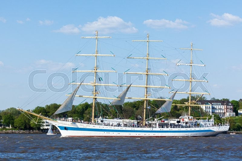 Editorial image of 'Hamburg, Germany - May 8, 2016: Russian three-masted sailing ship Sts MIR on the Elbe river during the departure parade of 827th hamburg Port Anniversary'