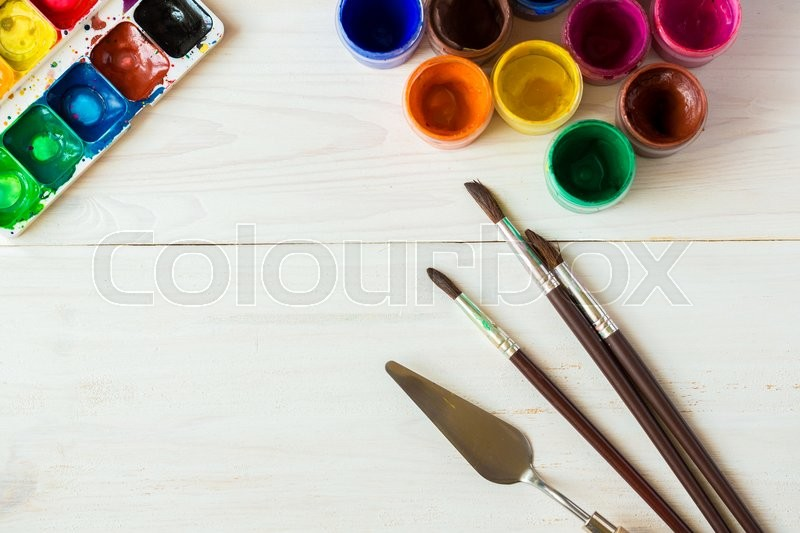 Art of Painting. Painting set: brushes, paints, watercolor, acrylic paint on a white wooden background top down view, stock photo