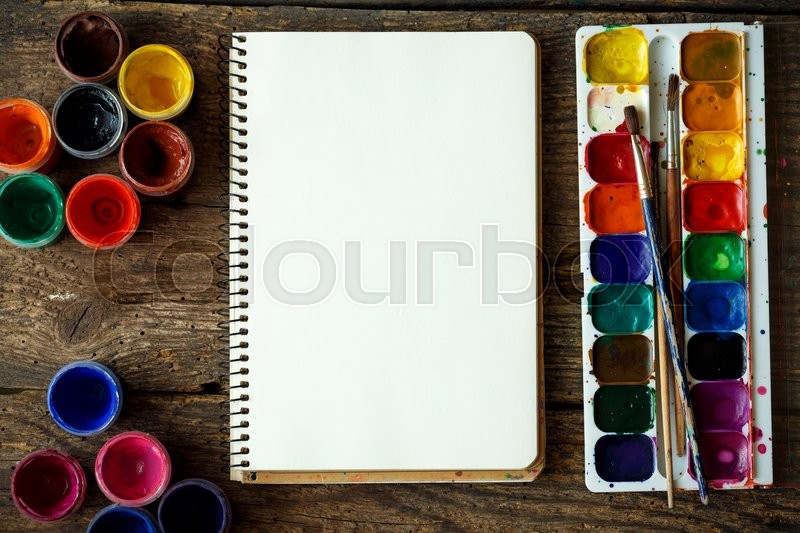 Stock image of 'Art of Painting. Painting set: brushes, paints, watercolor, acrylic paint on a wooden background top down view'