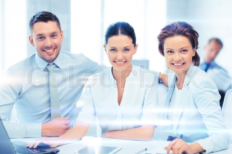 Stock image of 'business concept - business team working with tablet pc and laptop in office'