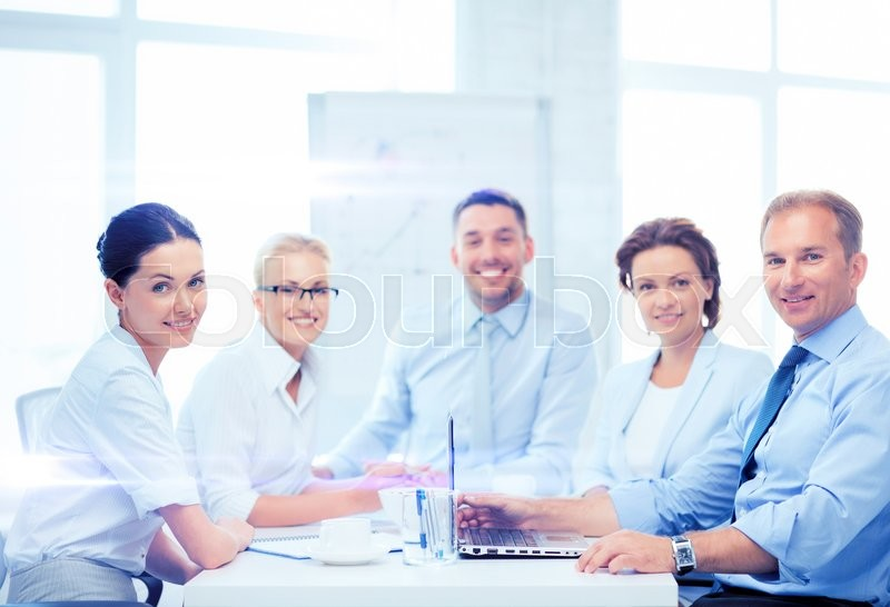 Stock image of 'business and office concept - business team having meeting in office'