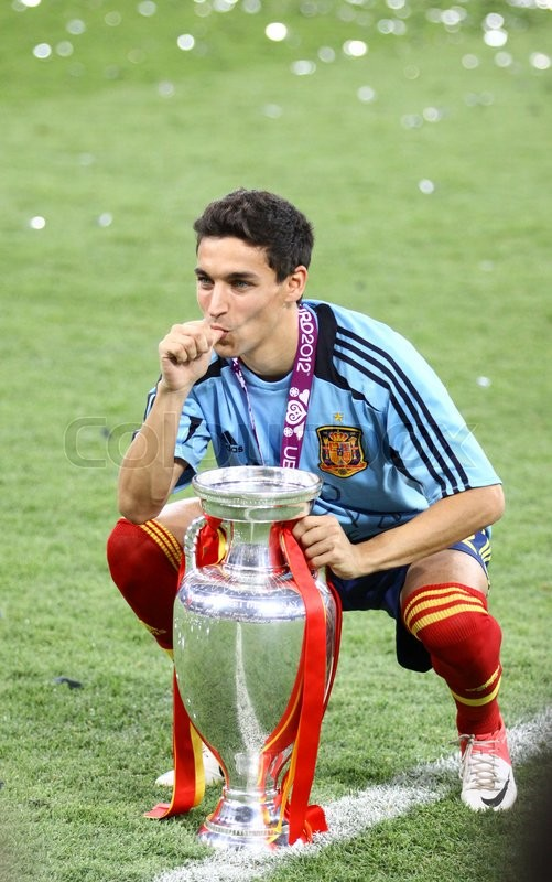 Editorial image of 'KYIV, UKRAINE - JULY 1, 2012: Jesus Navas of Spain poses for a photo with Trophy after UEFA EURO 2012 Final game against Italy at Olympic stadium in Kyiv. Spain won the game and the Tournament'