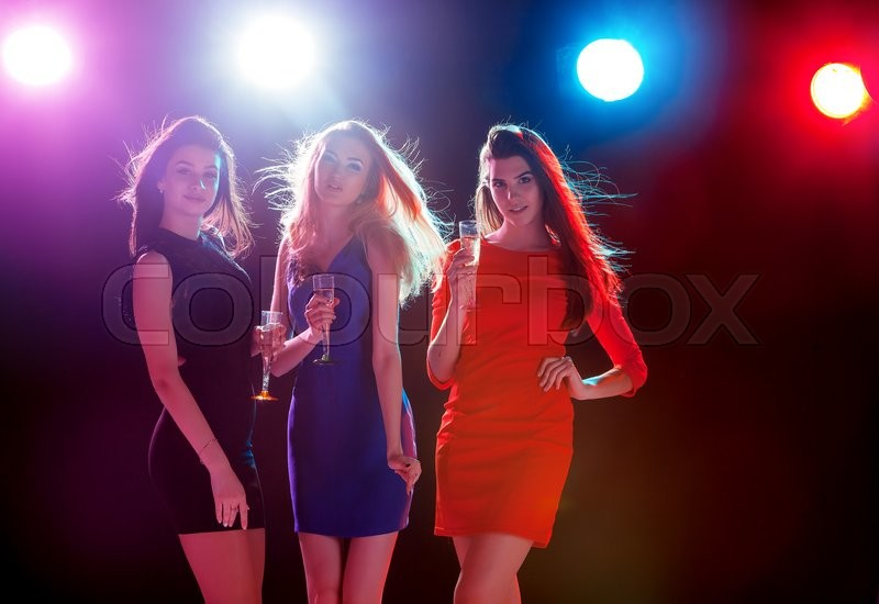 Stock image of 'Party, holidays, celebration, nightlife and people concept - smiling young beautiful girls dancing in club'