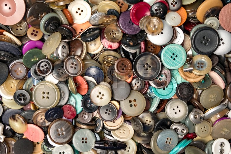 Stock Bild von 'many collected colorful buttons in a box'