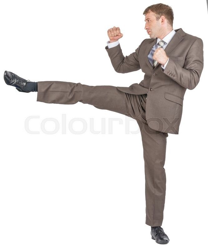 Stock image of 'Angry businessman kicking isolated on white background'