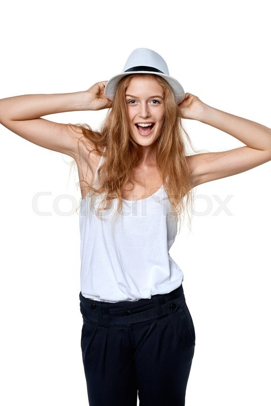 Stock image of 'Happy excited woman with straw hat laughing at camera'