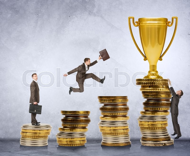 Stock image of 'Businessman trying to get gold cup moving on coins stairs'