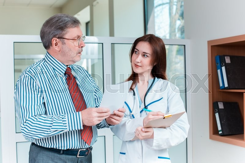 Stock image of 'The patient and his doctor in medical office. Healthcare concept'