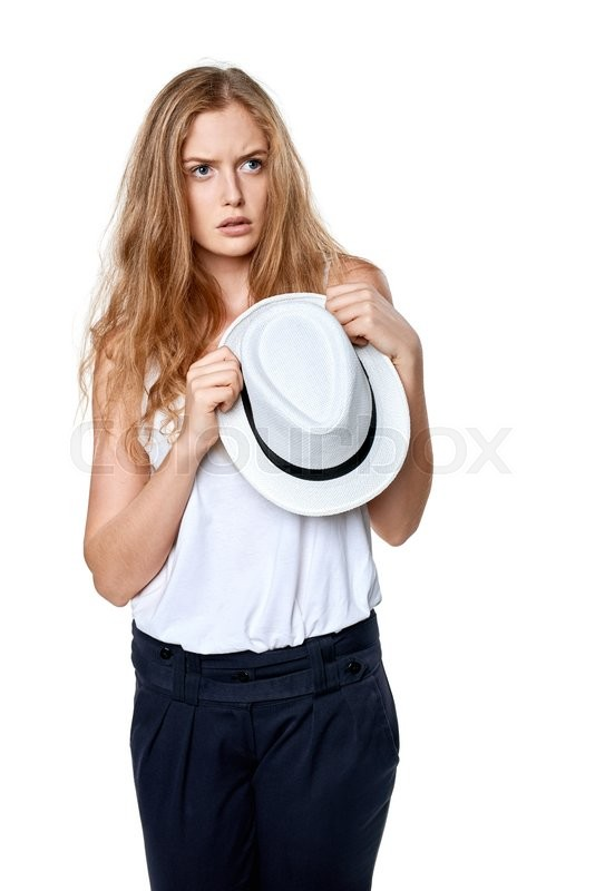 Stock image of 'Displeased sullen woman holding straw hat looking away at blank copy space'