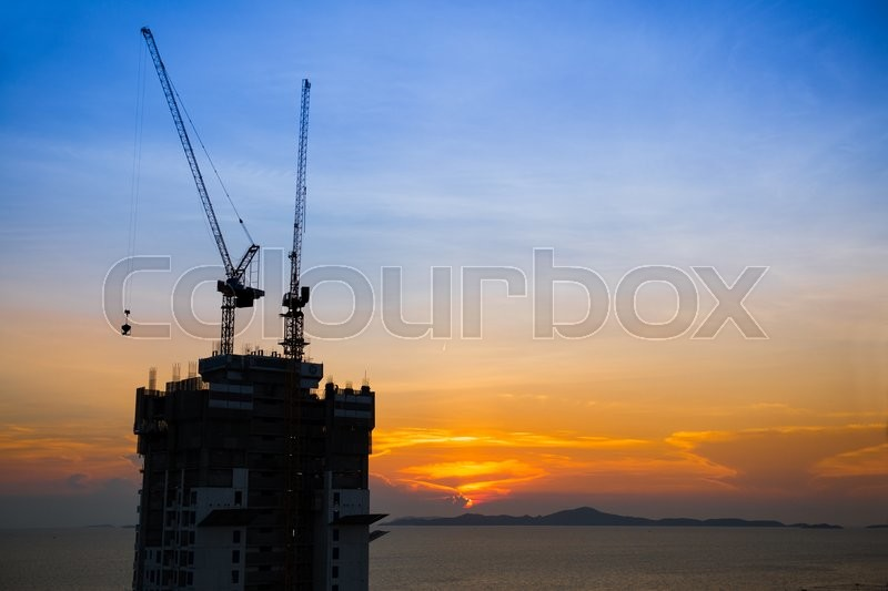 Stock image of 'Construction near the beach at sunset'