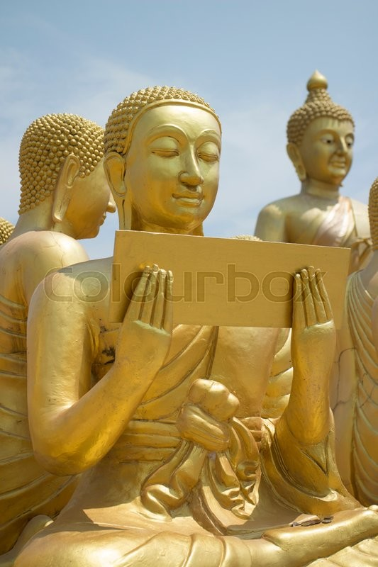 Stock image of 'Buddhist's Disciple statue and Big Buddha statue'