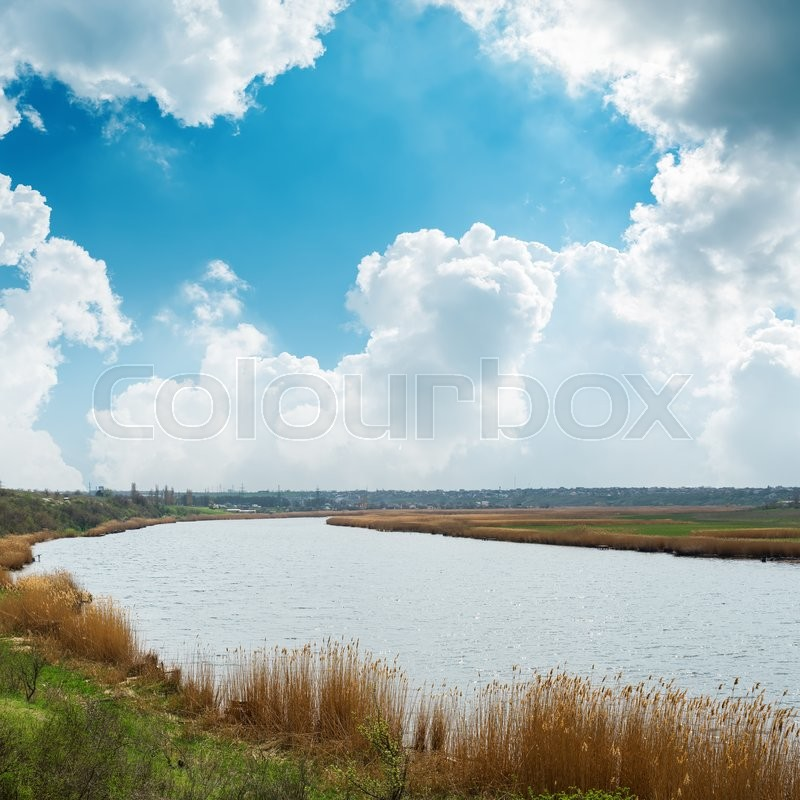 Stock image of 'Blue sky with clouds over river'