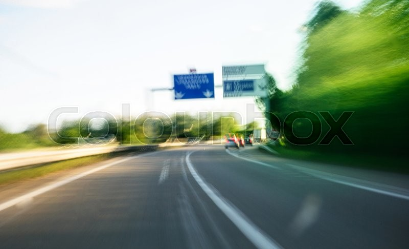 Stock Bild von 'transportation;blurred;, highway,, photography,'
