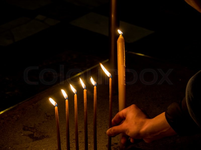 Stock image of 'flames of candles are pushed by the wind to the side'