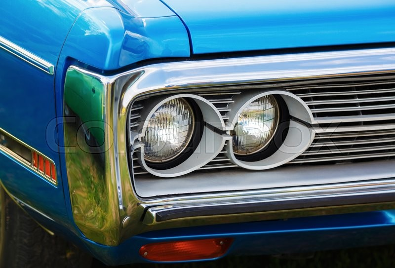 Stock image of 'Headlights of blue retro car. Retro styled blue classic car. Selective focus.'