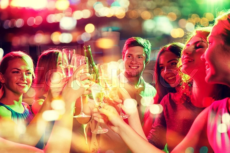 Party, holidays, celebration, nightlife and people concept - smiling friends clinking glasses of champagne and beer in club, stock photo