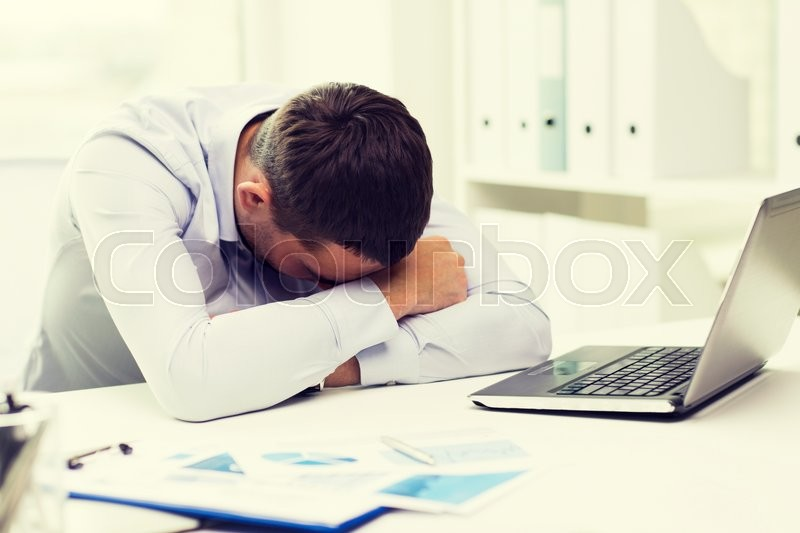 Stock image of 'business, people, fail, paperwork and technology concept - businessman with laptop computer and papers working in office'