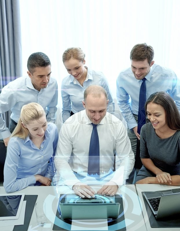 Stock image of 'business, people, technology and teamwork concept - smiling business team with laptop computer and virtual projection working in office'