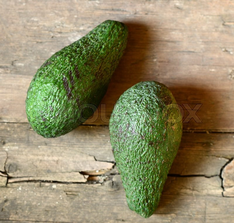 Stock image of 'Fresh avocado on wooden background'
