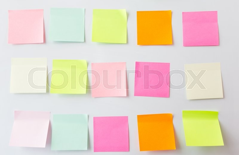 Stock image of 'business, information, memo, management and education concept - close up of blank paper stickers on white board'