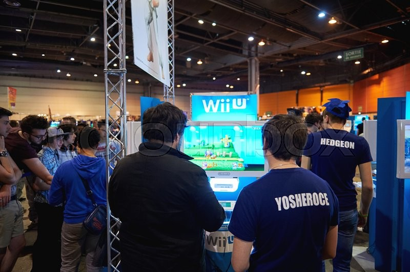 Editorial image of 'STRASBOURG, FRANCE - MAY 8, 2015: Kids and adults playing WII U game consoles at the open market Digital Game Manga Show'