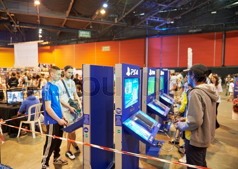 Editorial image of 'STRASBOURG, FRANCE - MAY 8, 2015: Kids and adults playing PS 4 game consoles at the open market Digital Game Manga Show'