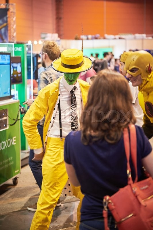 Editorial image of 'STRASBOURG, FRANCE - MAY 8, 2015: Man in The Mask movie yellow costume characther and Thunder man costume posing for visitors at the closed market Digital Game Manga Show'