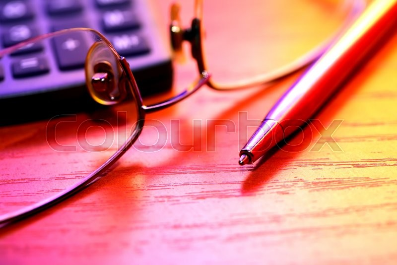 Stock image of 'Colorful still life with pen near spectacles and calculator'