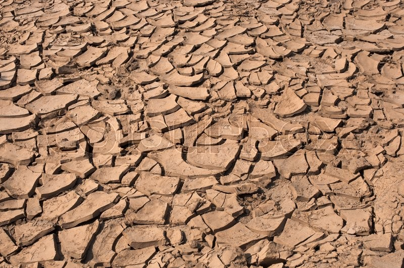 Stock image of 'Cracked dry land without water'