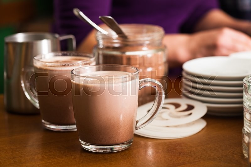 Stock image of 'Glass with cocoa with milk on the table in cafe'