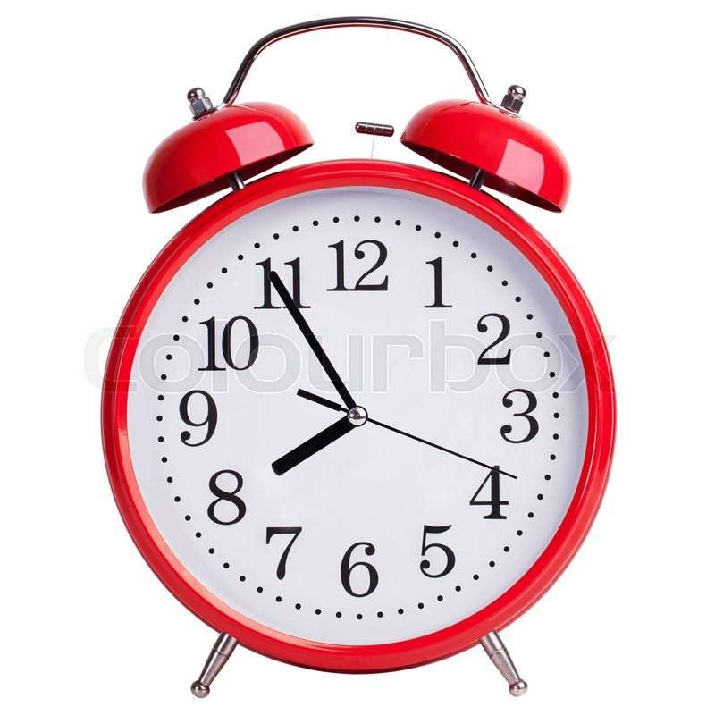 Stock image of 'Red round alarm clock shows five minutes to eight'