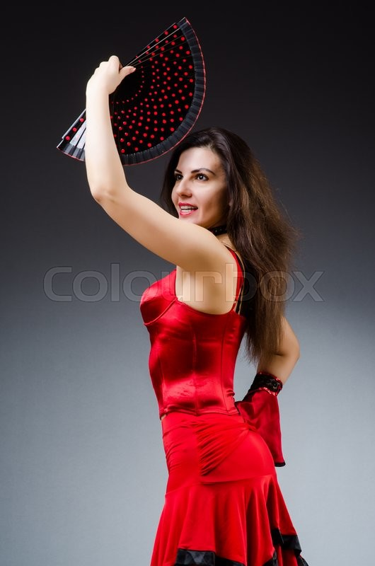 Stock image of 'Woman with fan dancing dances'
