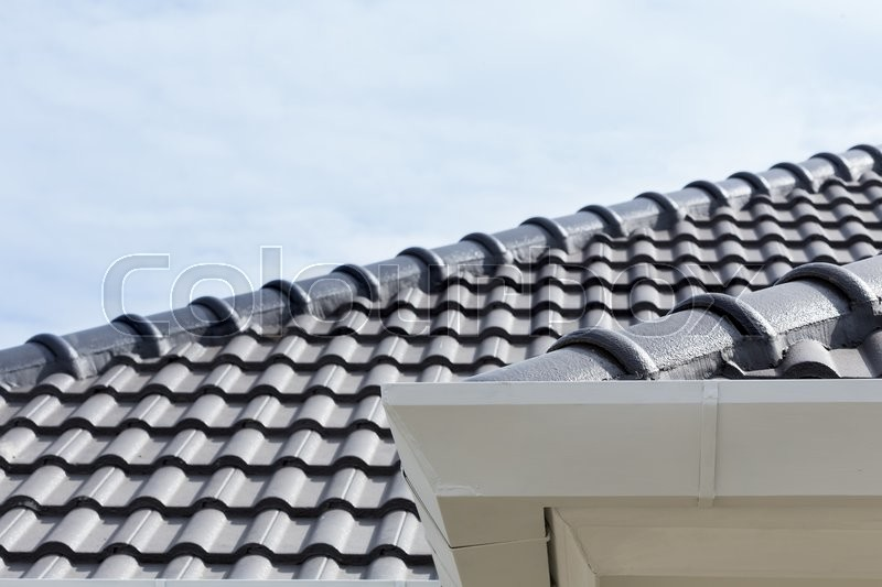 Stock image of 'White gutter on the roof top of house'