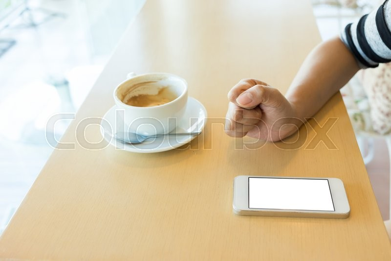 Stock image of 'Lifestyle of women using a mobile phone in cafe coffee shop'