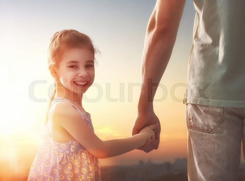 Stock image of 'Happy loving family. Father and his daughter child girl playing outdoors. Cute little girl and daddy. Concept of Father's day.'